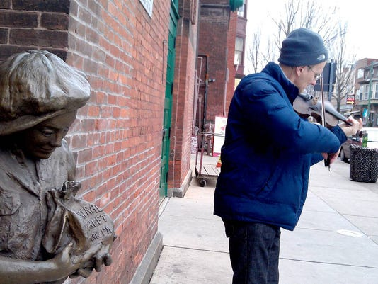 Hans Wolff plays violin outside of Central Market in February. Later this week, he's coming back.