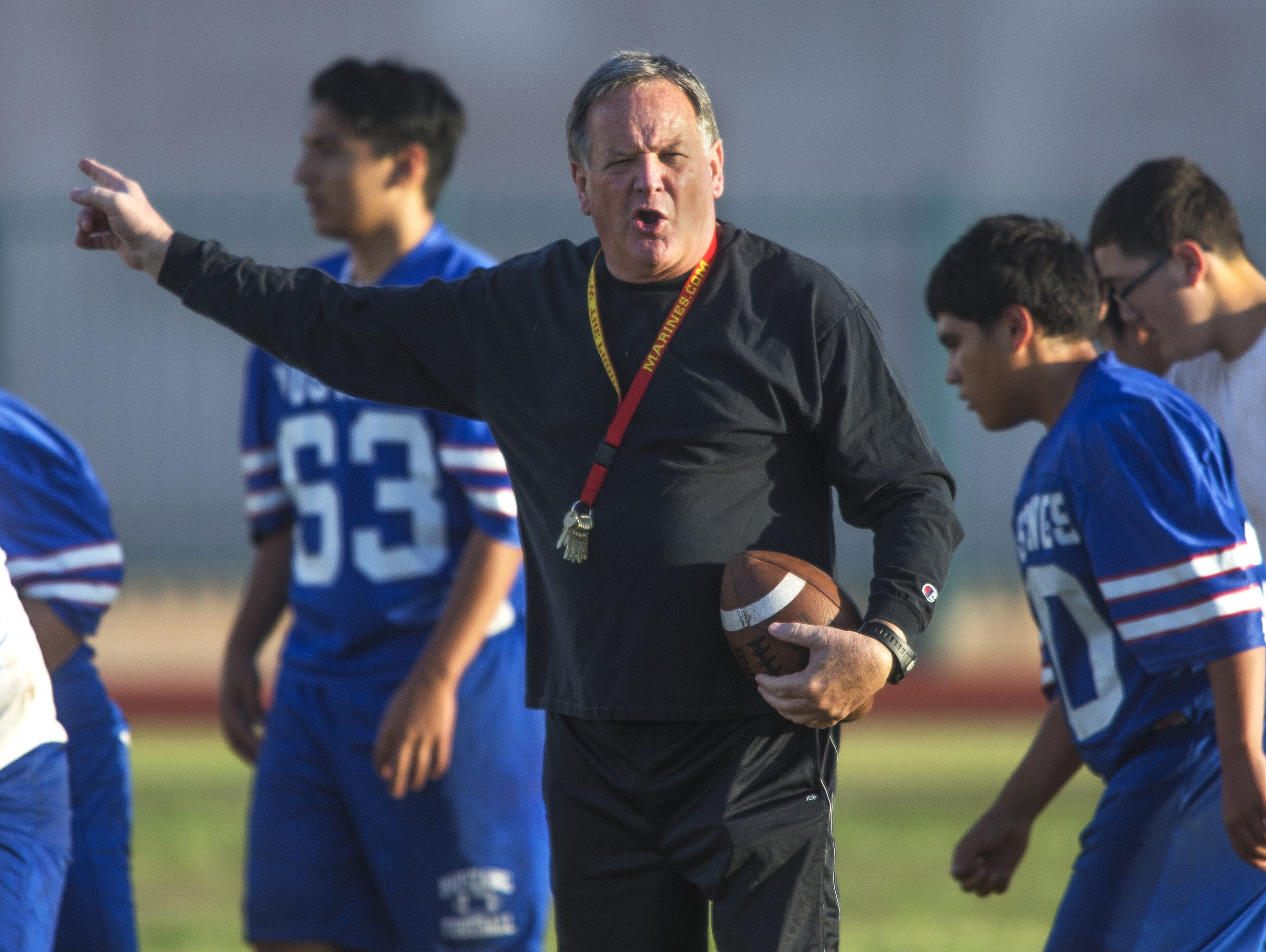North High School head football coach Bernie Busken gives instructions during practice at North High School early Wednesday morning, May 6, 2015.