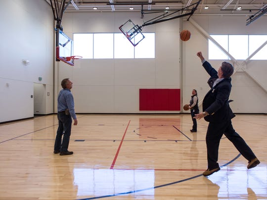 City Councilmember Ross Cunniff shoots hoops with city staff during an event unveiling the new Foothills Activity Center at Foothills Mall in Fort Collins on Thursday.