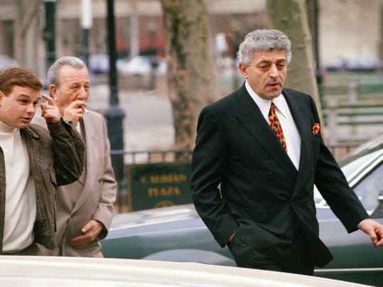 "John ""Jackie Nose"" D'Amico (right) arrives at a federal courthouse in Brooklyn, New York, on March 6, 1992, for continued testimony in the case of John Gotti."