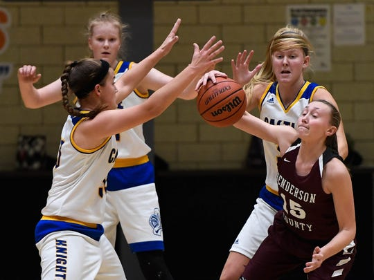 Henderson's Alyssa Dickson (15) looks for a hole in the Castle defense as the Castle Knights play the Henderson County Lady Colonels at Castle Tuesday, December 5, 2017.