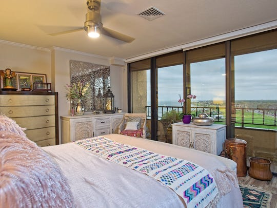 The master bedroom takes in breathtaking views of Corpus Christi Bay from a private balcony