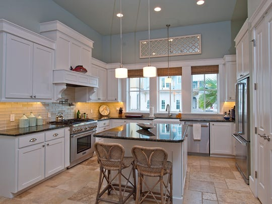 Cook in style in this amazing kitchen with all the top line stainless steel appliances, large island and cabinets galore