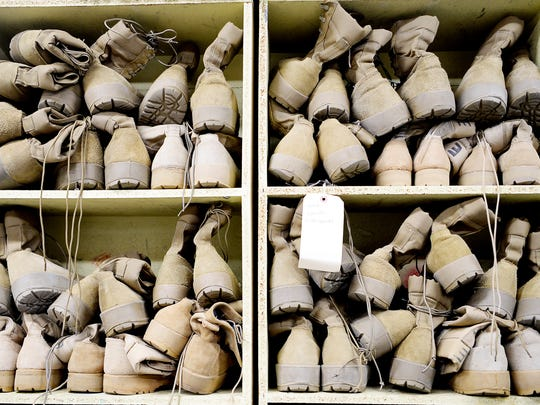 Cadet boots are piled in the JROTC armory at Erwin High School October 10, 2017.