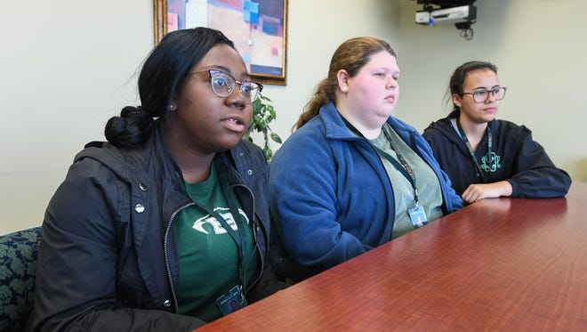 Berea High students, from left, student body president Jainada Williams, student body treasurer Mia Lacey, and senior class president Joana Londono discuss on Monday, March 12, 2018 their planed activities for Wednesday's walkout.