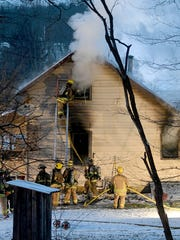 Multiple fire departments braved frigid temperatures on Wednesday night while also fighting a structure fire at 825 Marion Avenue Road North.