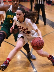North Non-Public B girls basketball sectional finals. Queen of Peace vs. Saddle River Day at Kennedy High School in Paterson on Wednesday, March 8, 2017. SRD #23 Michelle Sidor drives to the basket.