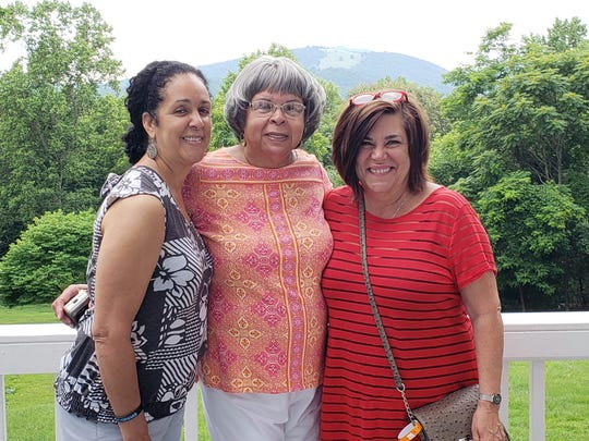 Wilmetta Cunningham Austin, center, stands with her daughter Denise Austin Lisath, at left, and daughter-in-law Karen Austin while visiting the home of Monticello tour guide Liz Russell. The trio attended the Juneteenth celebration at Monticello where they spoke with Russell who shares a picture of Austin's late son, Tracy Austin, when giving tours due to his resemblance to their ancestor Rev. Peter Fossett, a nephew of Sally Hemings.