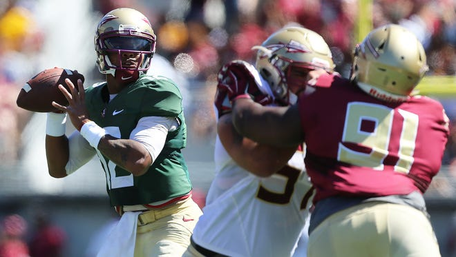 Deondre Francois (12) looks to throw the ball during the Florida State spring game at the Citrus Bowl.