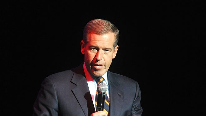 """Brian Williams, shown speaking at the 8th Annual Stand Up For Heroes event in 2014, was suspended as """"Nightly News"""" anchor and managing editor for six months without pay for misleading the public about his experiences covering the Iraq War."""