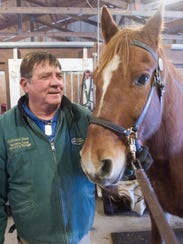 Hamburg Township resident Don Packard will ride his