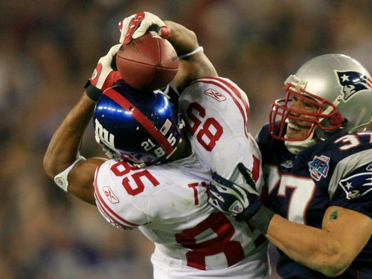 David Tyree of the New York Giants makes a catch in Super Bowl XLII on Feb. 3, 2008, in Glendale.