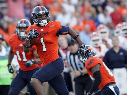 UTSA wide receiver Kam Jones looks for a defender as he runs into the endzone against UTEP at the Sun Bowl in 2013.