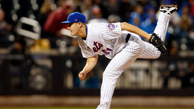 New York Mets relief pitcher Paul Sewald (51) pitches against the Miami Marlins during the ninth inning at Citi Field.