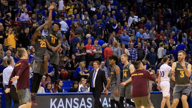 Arizona State forward Romello White (23) and guard Shannon Evans II (11) celebrate after an NCAA college basketball game against Kansas in Lawrence, Kan., Sunday, Dec. 10, 2017. Arizona State defeated Kansas 95-85.