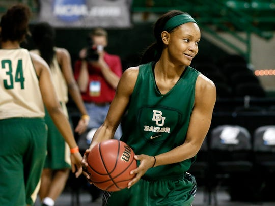 Baylor's Nina Davis prepares to make a pass during a practice for the first round of the NCAA Women's Tournament.