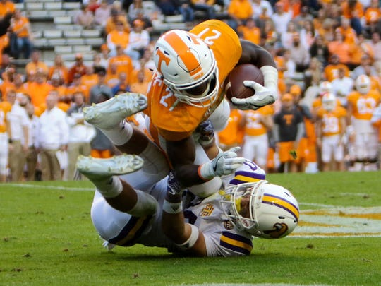 Despite leading Tennessee with a 6.9-yard average last season and not playing the position in high school, former Naples running  back Carlin Fils-aime has switched to cornerback for the Volunteers.