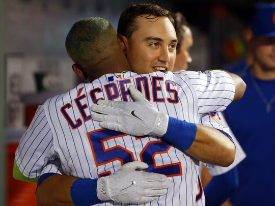 Mets center fielder Michael Conforto (30) hugs left fielder Yoenis Cespedes (52) after hitting his second two run home run of the game against the Oakland Athletics during the seventh inning at Citi Field on Friday, July 21, 2017.