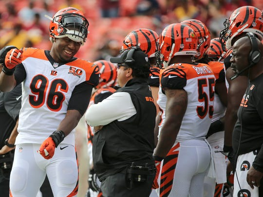 Cincinnati Bengals defensive end Carlos Dunlap (96) smiles at Cincinnati Bengals defensive coordinator Paul Guenther in the first quarter during the Week 3 NFL preseason game between the Cincinnati Bengals and Washington, Sunday, Aug. 27, 2017, at FedEx Field in Landover, Maryland.