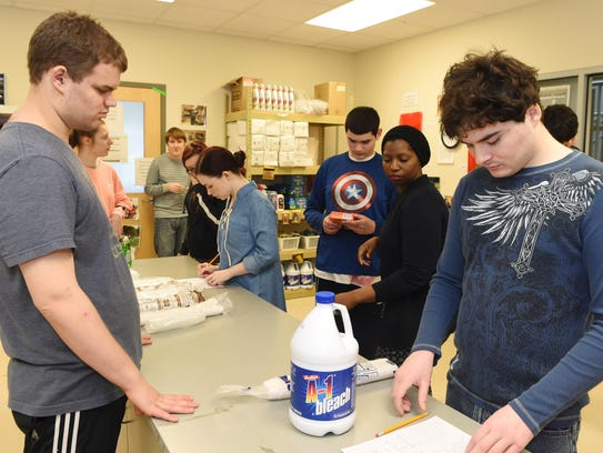 Residents organize supplies at the Anderson Center