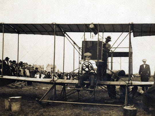 "Aviator Peck at the controls, waiting for his crew to put the propeller on the plane that would make the first ""Wings Over Chambersburg"" flight on September 23,1911."
