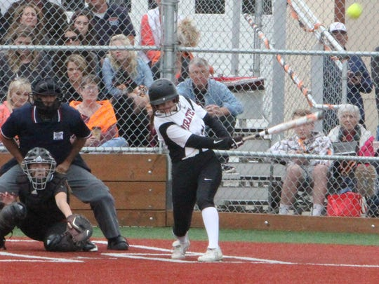 Dayton pitcher Haley Couch hits a home run against Scio on Tuesday, May 30, 2017.