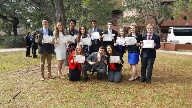 Gulf Coast High School students celebrate after winning several awards at Florida's largest student-run Model UN conference, GatorMUN XV, at the University of Florida in January. In mid-February, about 20 students will travel to the North American Invitational Model United Nations Conference (NAIMUN) in Washington, D.C. for a chance to earn national recognition once again.