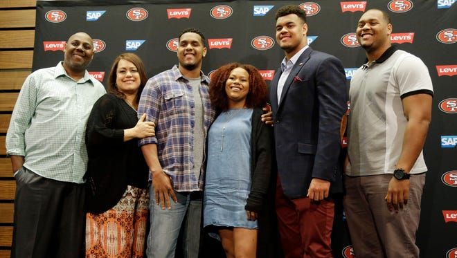 San Francisco 49ers first-round draft pick Arik Armstead, second from right, poses for a family photo with his father Guss, mother Christa, brother Aaron, sister Alexis and brother Armond after an NFL football news conference Friday, May 1, 2015, in Santa Clara, Calif.