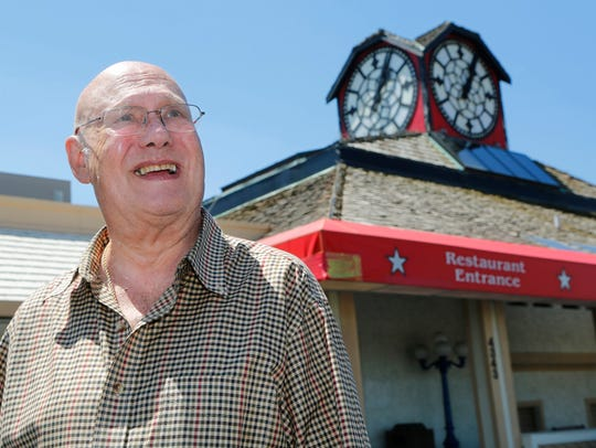 In this photo from 2016, Roy Meeks, former owner of the Best Western hotel, discusses the history of the iconic clock above the Hour Time restaurant at 4343 South Street in Lafayette. Meeks said the clock was placed above Hour Time restaurant in 1979. Meeks said the clock was built in Leicester, England in 1910. The clock was once above the Rochdale train station, also in England.