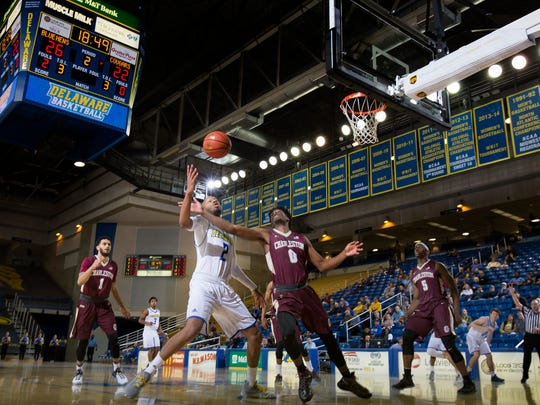 Delaware's Barnett Harris (No. 2) and Charleston's Chevez Goodwin (No. 0) fight for a rebound in the second half of the University of Delaware's 65-56 loss to the College of Charleston at the Bob Carpenter Center in Newark on Monday night.