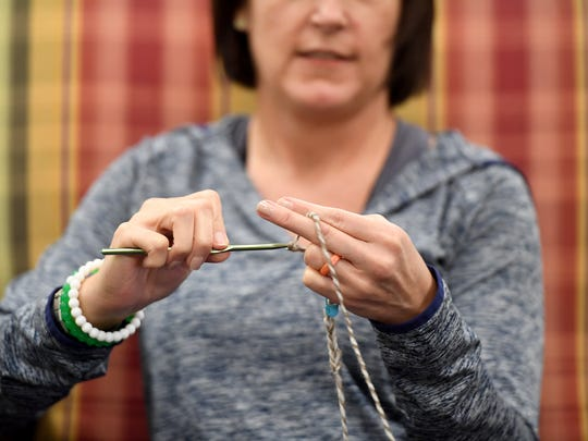 Val Exum works on a crochet piece during the prayer shall ministry meeting, Wednesday, May 10, at First United Methodist Church.