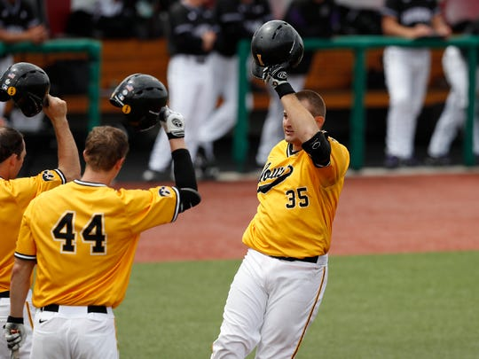 Iowa Hawkeyes first baseman Jake Adams (35) celebrates his first home run against the Northwestern Wildcats in the Big Ten Tournament championship game Sunday, May 28, 2017 at Bart Kaufman Field in Bloomington, Ind. (Brian Ray/hawkeyesports.com)
