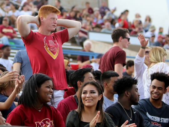 A Midwestern State fan reacts to a play in the game against Tarleton State Saturday, Nov. 4, 2017, at Memorial Stadium in Wichita Falls.