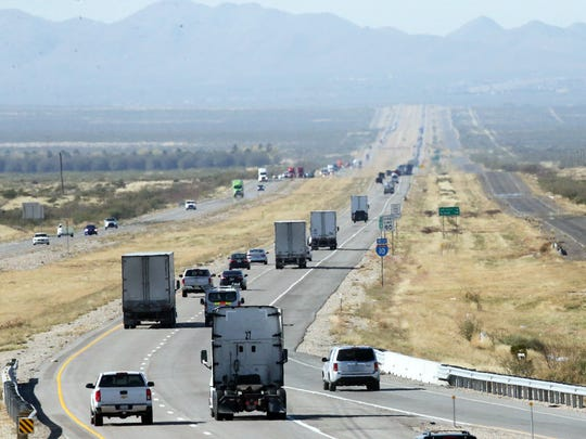 Traffic flows Wednesday along Interstate 10, looking west from the Plateau Truck & Auto Plaza, about seven miles from the area where a U.S. Border Patrol agent was fatally injured in the line of duty Nov. 18. The agent died the next day at a hospital in El Paso.