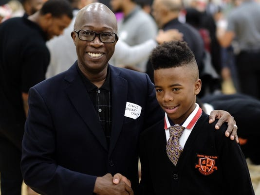 Hundreds of men show up for school's dad event