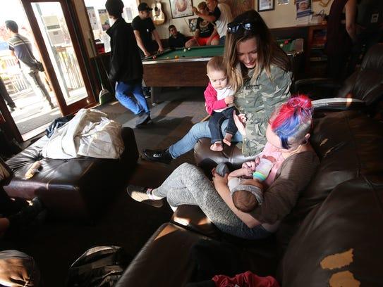 Debora Lascelles holds daughter Ellie while visiting