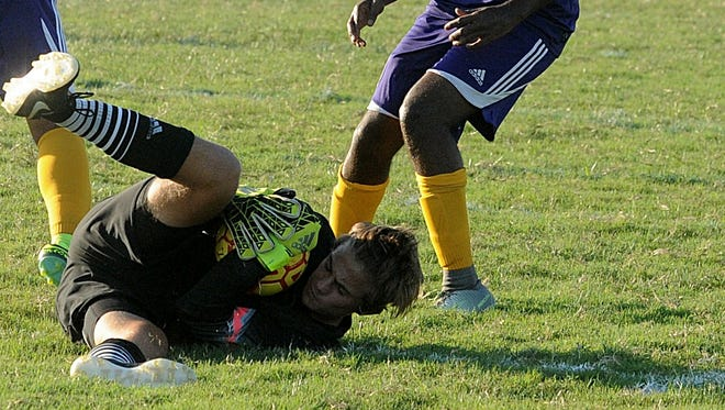 Stephen Decatur goalkeeper Noah Shockley snatches the ball away from the feet of Crisfield's Jordan Sterling on Wednesday, Sept. 14 in Berlin.
