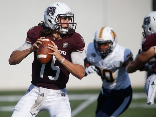 Quarterback Peyton Huslig looks for an opening as Missouri State University took on Murray State in the Bears football home opener on Saturday, Sept. 16, 2017.