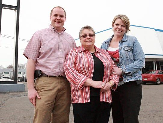 In this 2015 photo, Daniel Wheeler, Ann Wheeler (center)