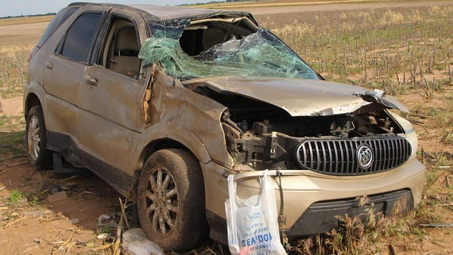 A 2006 Buick Rendezvous sits in a field north of NE 90 Street on NE 70th Avenue after 35-year-old Jacob Davis of Macksville lost control, went in the west ditch, slid across the road into the east ditch the hit an embankment and rolled multiple times. Davis was not wearing a seat belt and ejected. He was pronounced dead at the scene.
