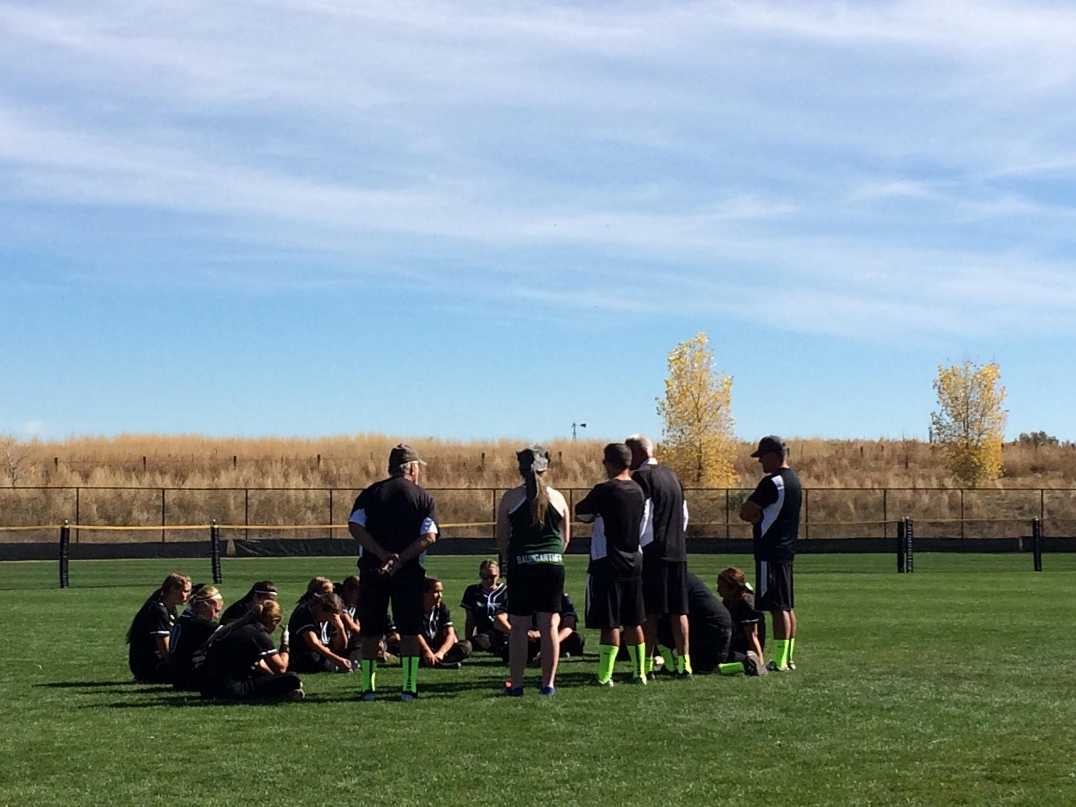 The Fossil Ridge softball team talks after a 13-11 loss to Pomona in the state semifinals.