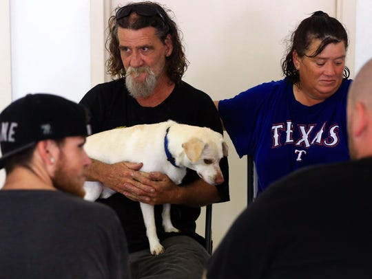 Happy Newman (left) and Tammy Newman wait at a shelter