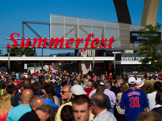 Concertgoers line up outside of the Summerfest grounds