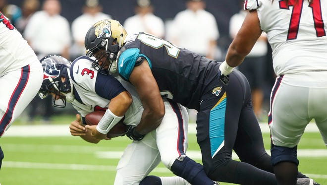 Sep 10, 2017; Houston, TX, USA; Houston Texans quarterback Tom Savage (3) is sacked by Jacksonville Jaguars defensive tackle Calais Campbell (93) during the second quarter at NRG Stadium. Mandatory Credit: Troy Taormina-USA TODAY Sports ORG XMIT: USATSI-358849 ORIG FILE ID:  20170910_kms_at5_128.JPG