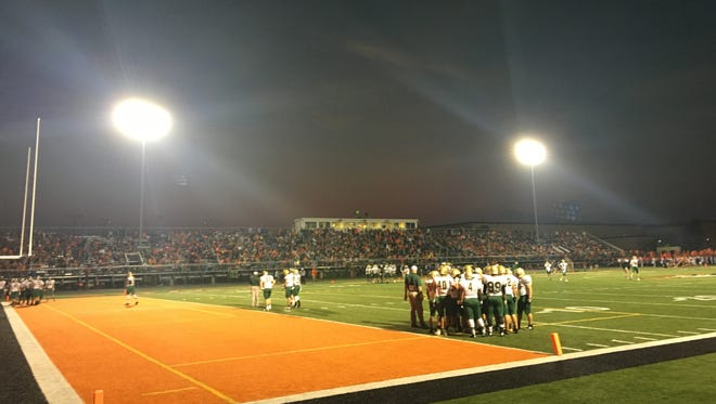 The West High Trojans warm up before their game at Cedar Rapids Prairie. Sept. 23, 2016