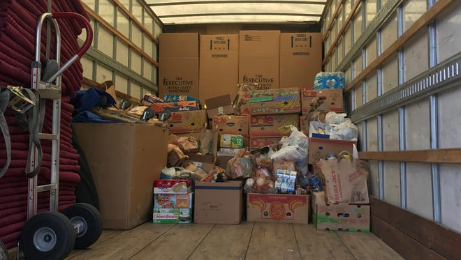 A truck at the Tempe Community Action Agency food drive was filled with cans and boxes of nonperishable food items throughout the morning on Aug. 12, 2017.