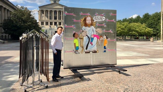 Daniel Vander Ley displays a painting of Jesus spanking a child at Legislative Plaza in Nashville Sept. 20, a demonstration against corporal punishment.