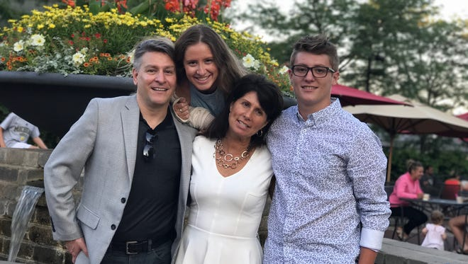 Dan O'shea, from left, with daughter Jess, wife Lisa and son Nick, a senior kicker on the West Bloomfield football team. O'Shea died of a heart attack on Tuesday, Oct. 10, 2017. He was 52.