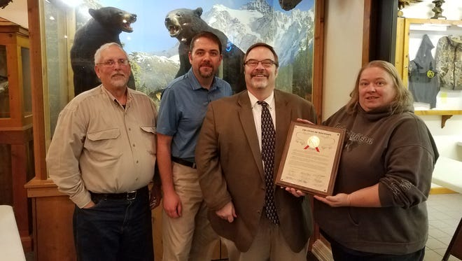 Manitowoc County Fish and Game was recently honored by the State of Wisconsin for providing 110 years of continuous conservation work in Manitowoc County. Pictured, from left: Manitowoc County Fish and Game Protective Association Secretary Elmer Schill, Vice President Dan Dufek, State Rep. Paul Tittl and Treasurer Marilee Stueck holds the proclamation from the State of Wisconsin.