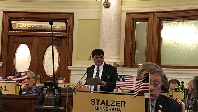 Sen. Al Novstrup, R-Aberdeen, stands to speak on behalf of Senate Bill 110 Tuesday in Pierre.